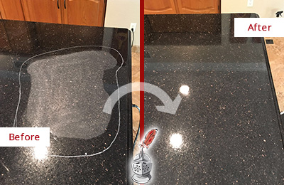 Before and After Picture of a Black Granite Countertop with Etching