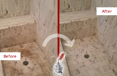 Before and After Picture of a Greater Sun Center Marble Shower Honed to Remove Dark Stains